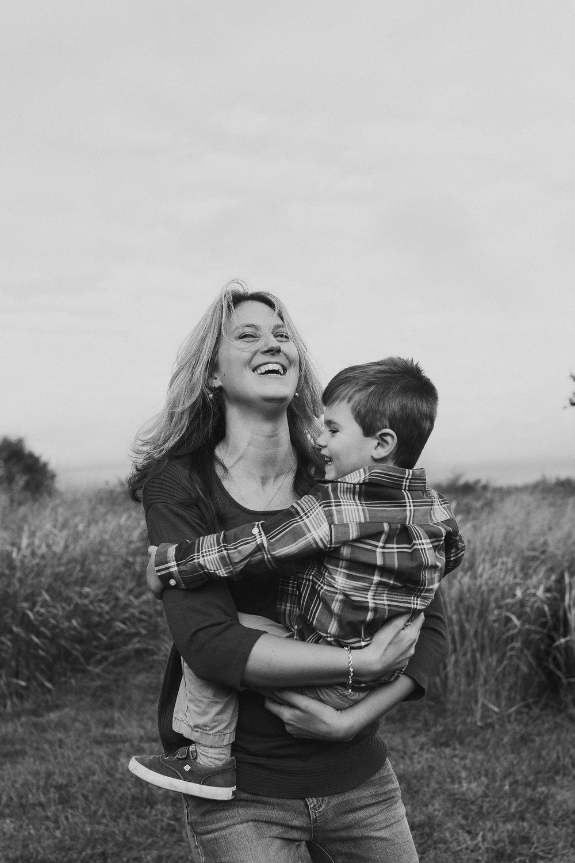 black and white mother son laugh spin fall autumn lifestyle documentary family Beaverdam Run Ashburn Virginia Loudoun Marti Austin Photography