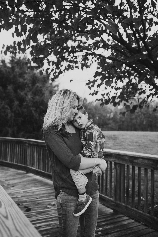 black and white mother son hug fall autumn lifestyle documentary family Beaverdam Run Ashburn Virginia Loudoun Marti Austin Photography