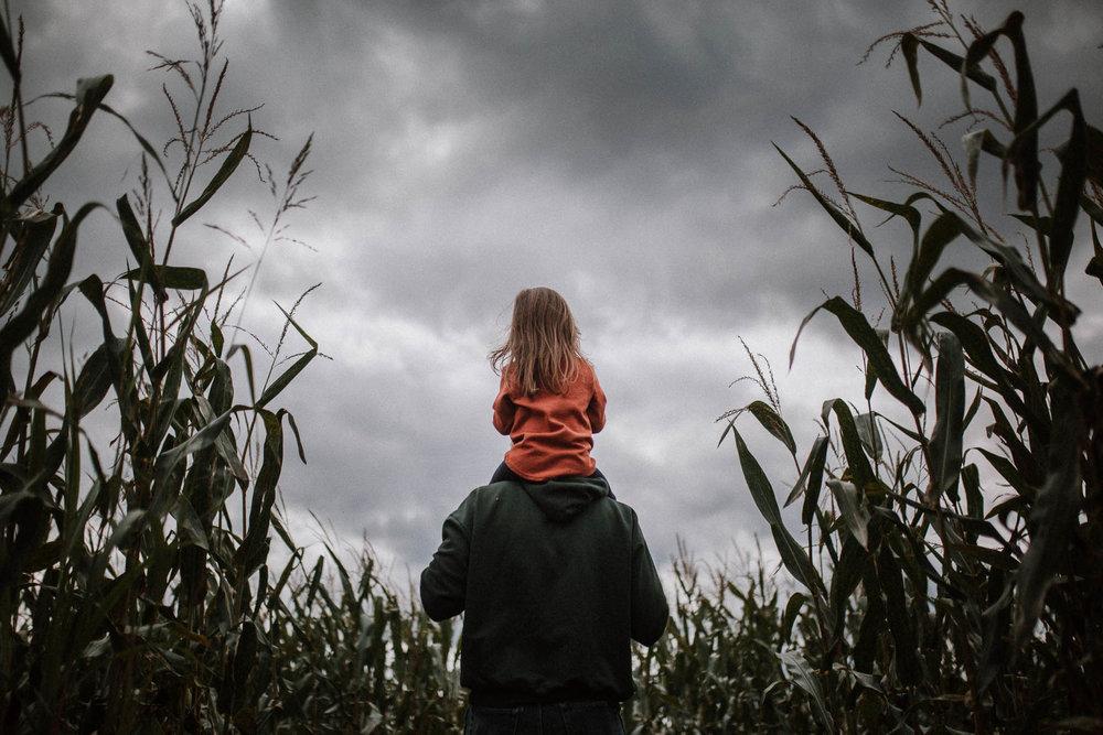 toddler daughter fathers shoulders corn maze clouds storm Ashburn Loudoun Virginia Lifestyle Documentary Family Marti Austin Photography