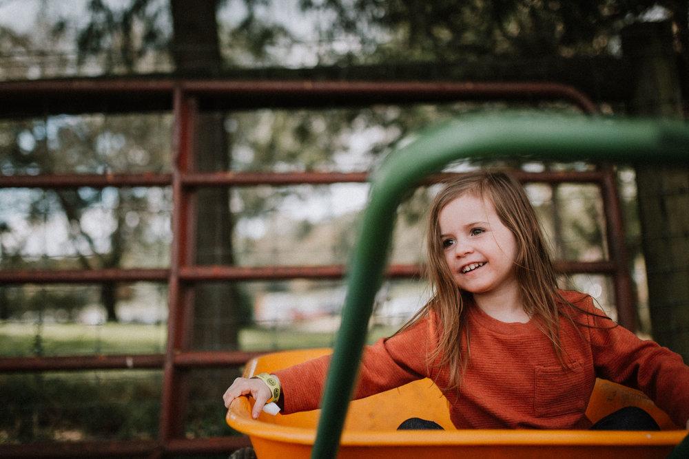 toddler in wheelbarrow farm pumpkin patch Ashburn Loudoun Virginia Lifestyle Documentary Family Marti Austin Photography