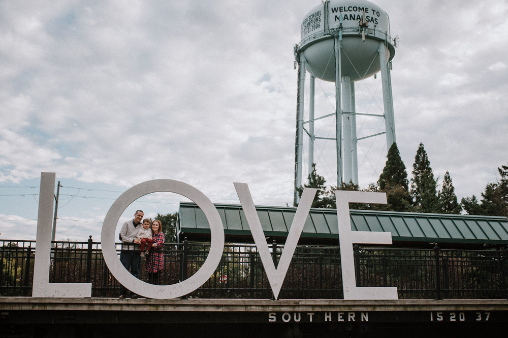Love sign family of three fall autumn lifestyle documentary family Historic Old Town Manassas Virginia Marti Austin Photography