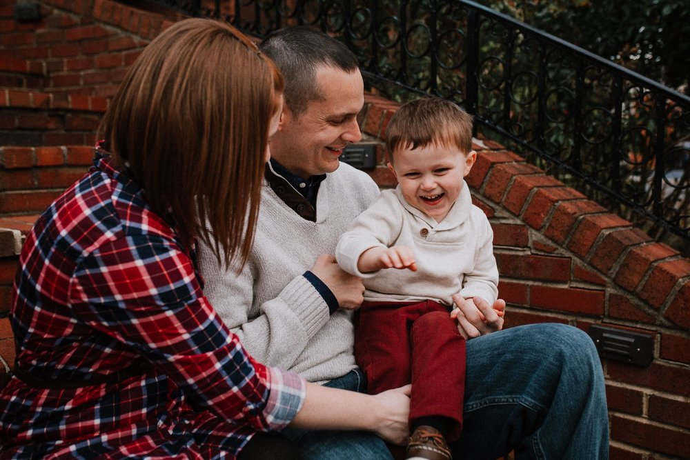 family of three mother father son toddler tickle laugh fall autumn lifestyle documentary family Historic Old Town Manassas Virginia Marti Austin Photography