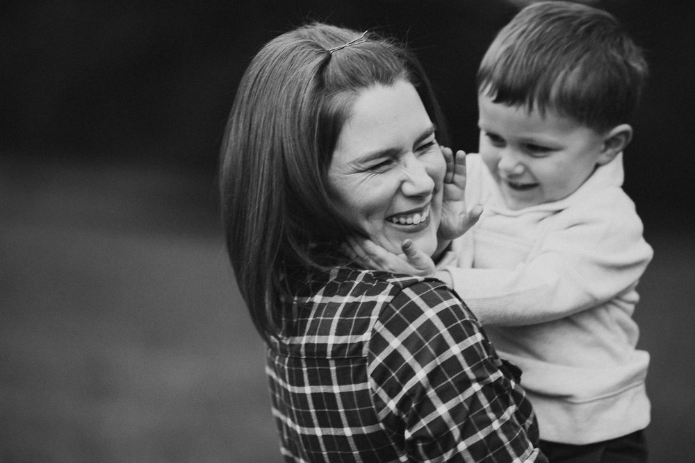 Black and white mother son hug laugh fall autumn lifestyle documentary family Historic Old Town Manassas Virginia Marti Austin Photography