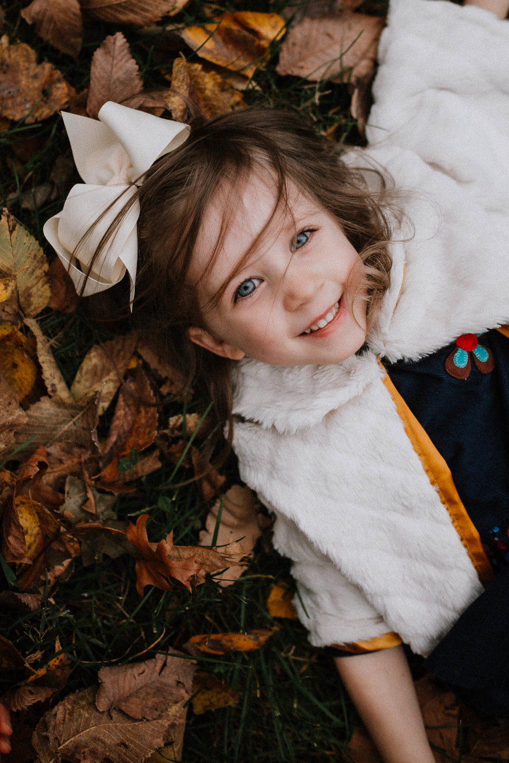 Toddler girl portrait leaves fall autumn family lifestyle documentary Heritage Farm Museum Claude Moore Park Sterling Virginia Marti Austin Photography
