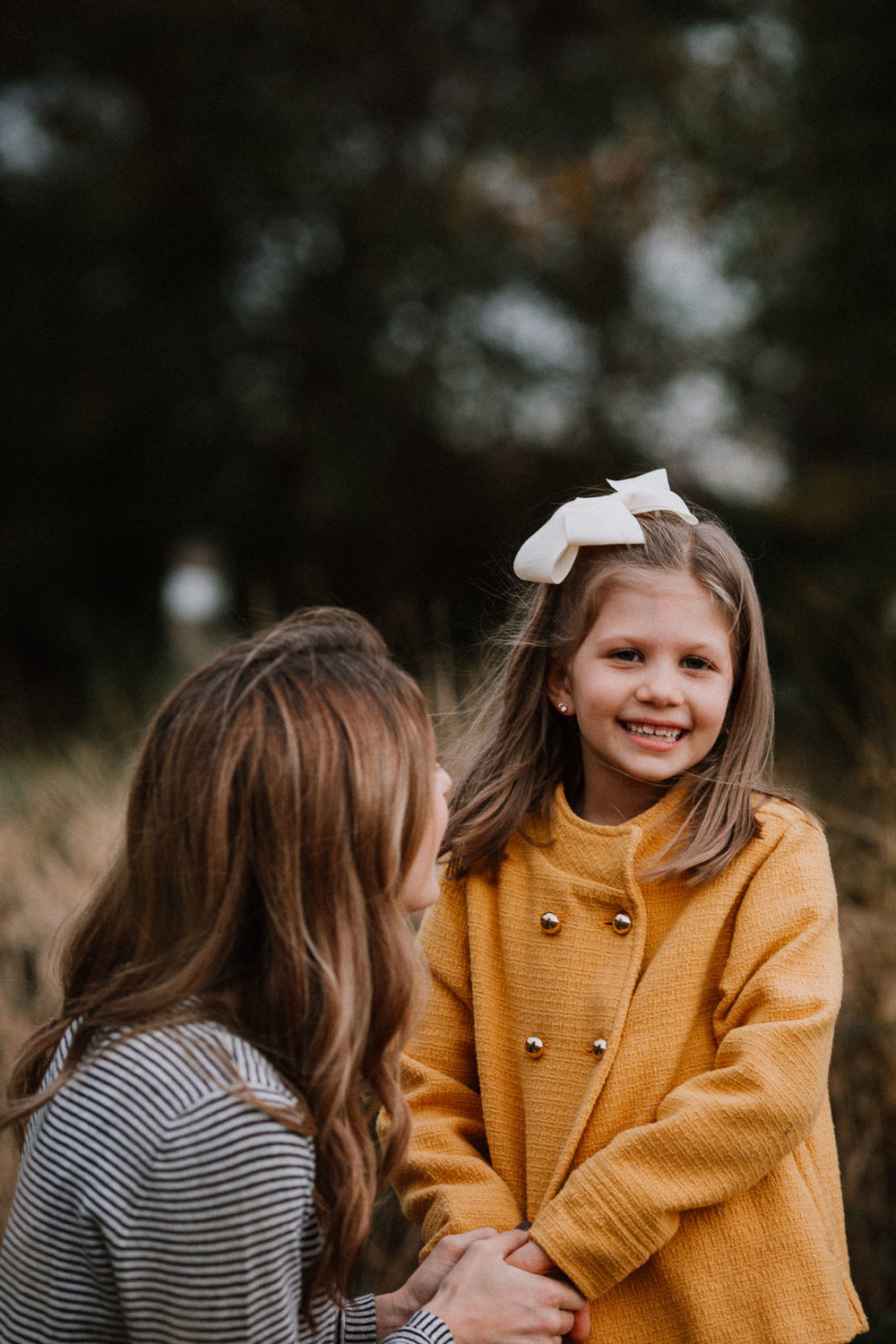 mother daughter holding hands laughing fall autumn family lifestyle documentary Heritage Farm Museum Claude Moore Park Sterling Virginia Marti Austin Photography