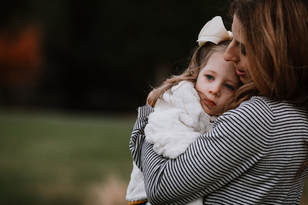 mother daughter hug fall autumn family lifestyle documentary Heritage Farm Museum Claude Moore Park Sterling Virginia Marti Austin Photography