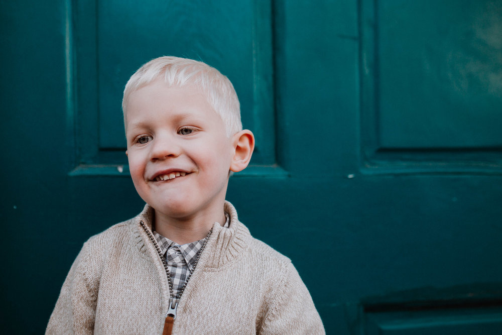 childhood boy portrait blue door fall autumn lifestyle documentary family Historic Downtown Leesburg Loudoun Virginia Marti Austin Photography