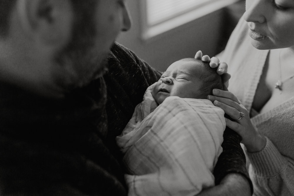 black and white mother father daughter in home lifestyle documentary newborn baby girl family Aldie Loudoun Virginia Marti Austin Photography