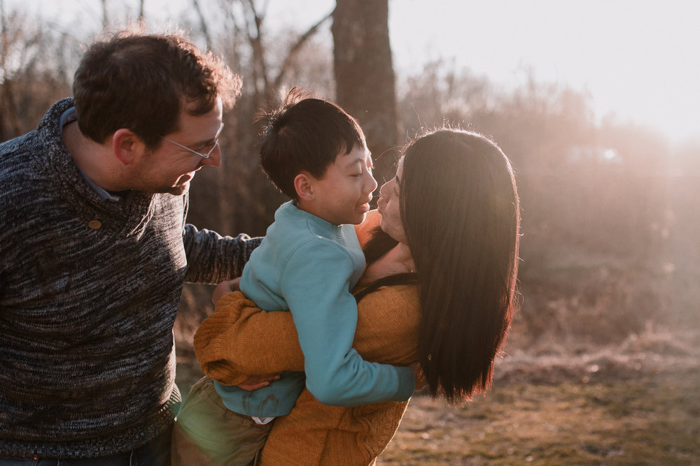 family of three mother father son Lifestyle Documentary Found Families Adoption Outdoor Golden Hour Sunset Colvin Run Mill Great Falls Virginia Marti Austin Photography
