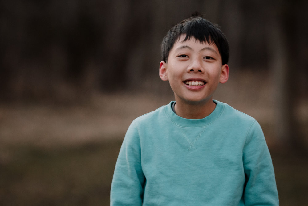 smiling boy portrait Lifestyle Documentary Found Families Adoption Outdoor Golden Hour Sunset Colvin Run Mill Great Falls Virginia Marti Austin Photography