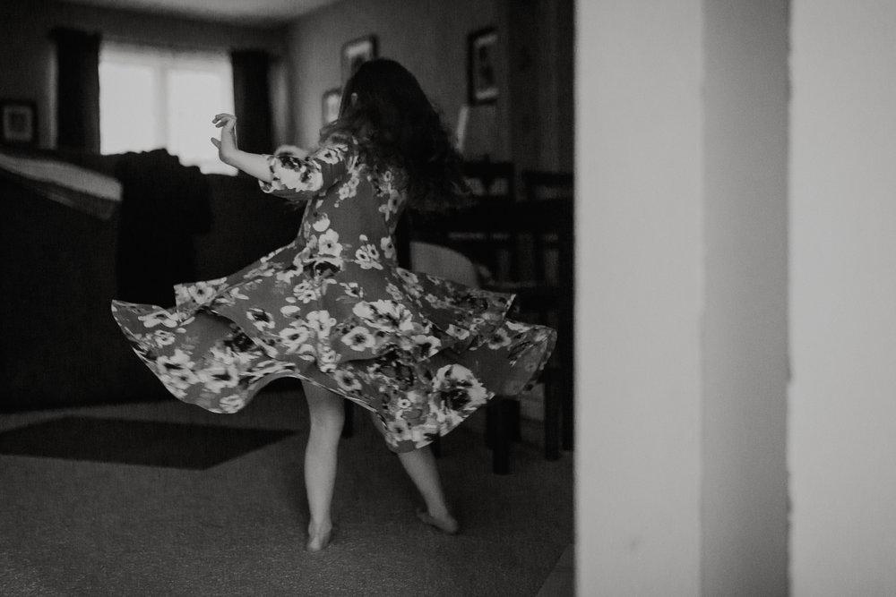 Black and white childhood girl dress twirl lifestyle documentary movement Ashburn Virginia Marti Austin Photography