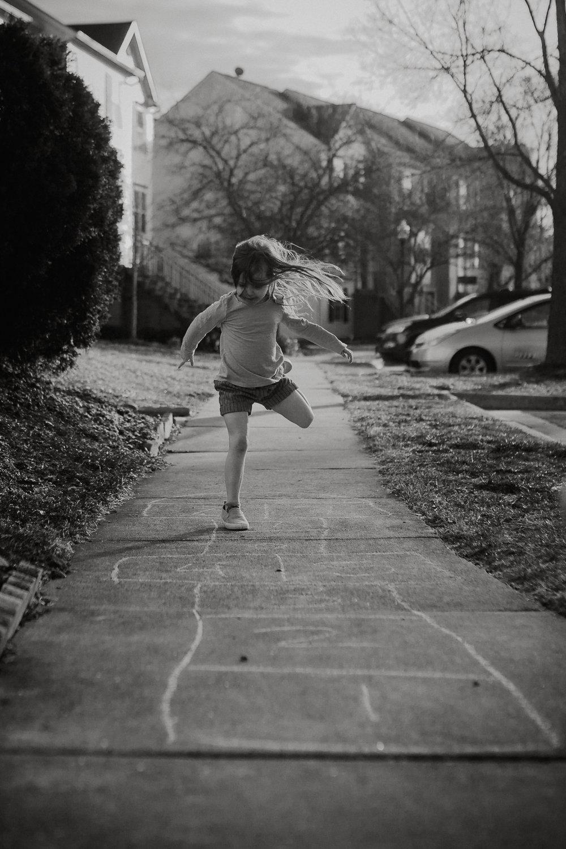 black and white hopscotch movement childhood lifestyle documentary Ashburn Virginia Marti Austin Photography