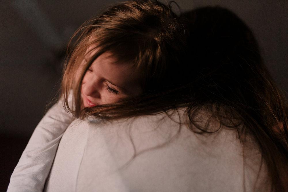 mother daughter hug head rests on shoulder eyelashes childhood lifestyle documentary Ashburn Virginia Marti Austin Photography