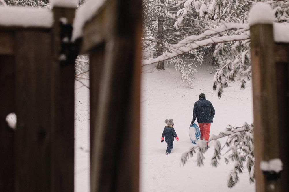 father daughter snow hill sledding winter childhood lifestyle documentary Ashburn Virginia Marti Austin Photography