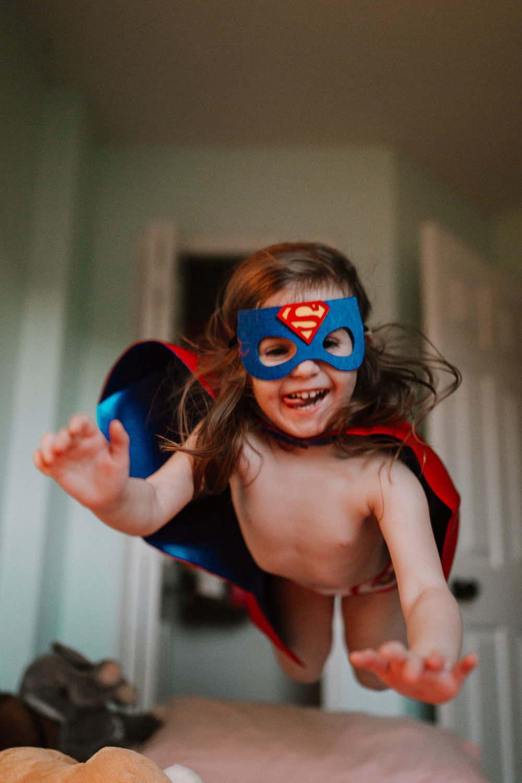 superhero mask cape jump bed childhood lifestyle documentary Ashburn Virginia Marti Austin Photography