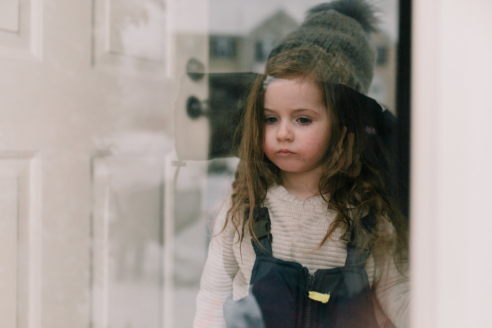 girl window door reflection winter snow childhood lifestyle documentary Ashburn Virginia Marti Austin Photography