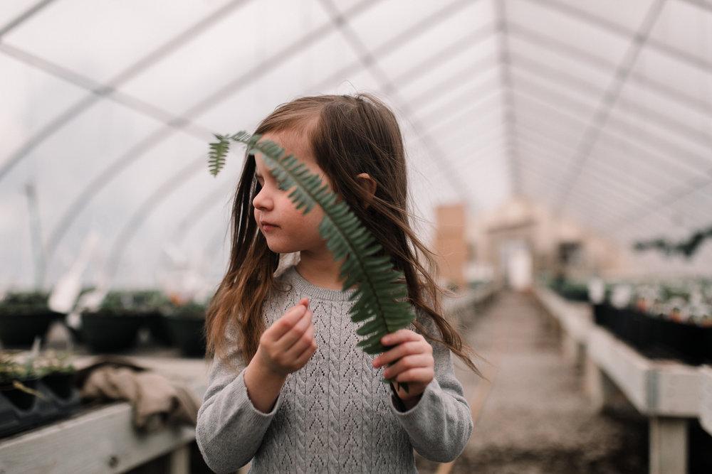 girl greenhouse fern leaf outdoor lifestyle documentary family Ashburn Loudoun northern Virginia  childhood Marti Austin Photography