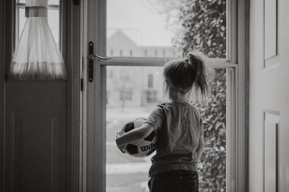 black and white portrait soccer ball window door lifestyle documentary family Ashburn Loudoun northern Virginia  childhood Marti Austin Photography