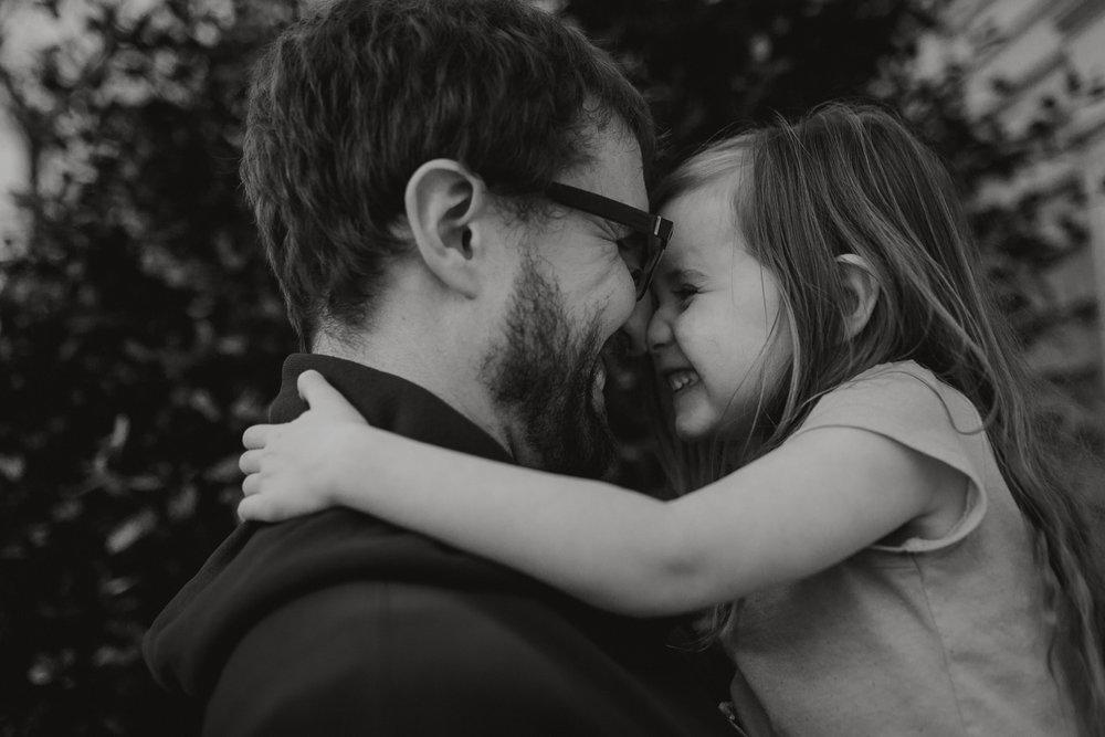 black and white father daughter laugh hug kiss lifestyle documentary family Ashburn Loudoun northern Virginia  childhood Marti Austin Photography