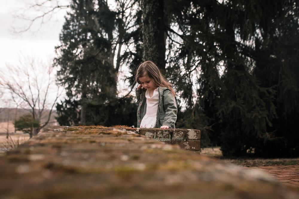 girl brick wall moss outdoors lifestyle documentary family Ashburn Loudoun northern Virginia  childhood Marti Austin Photography