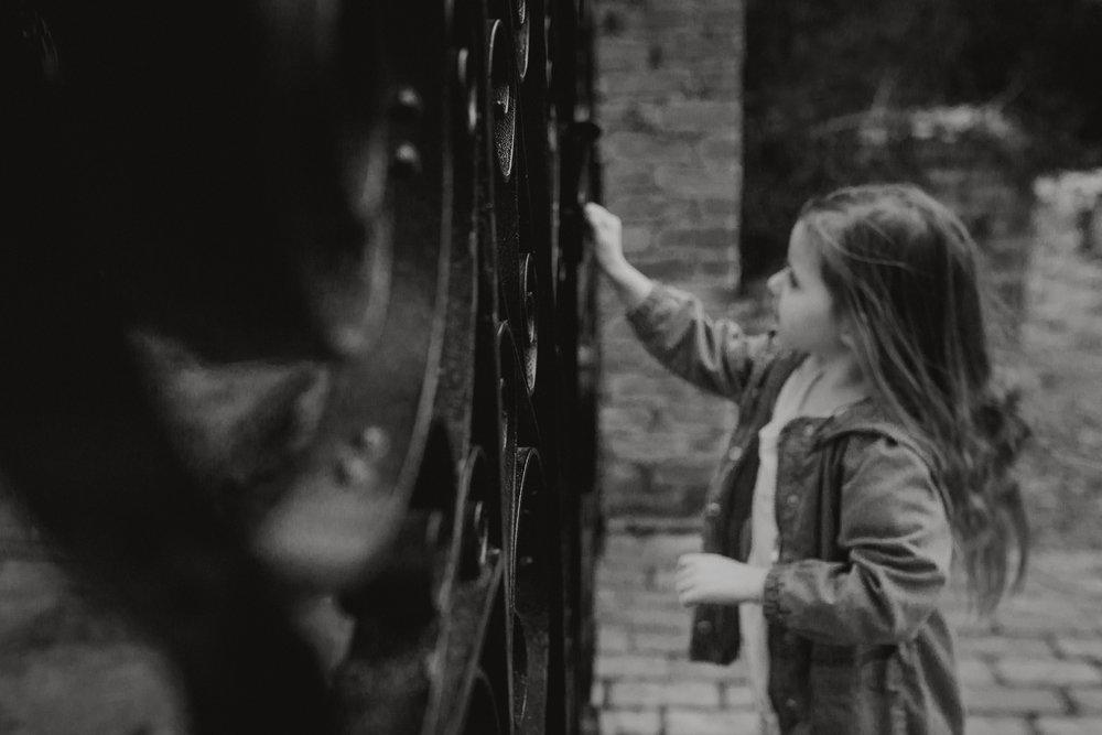 black and white girl opening gate lifestyle documentary family Ashburn Loudoun northern Virginia  childhood Marti Austin Photography