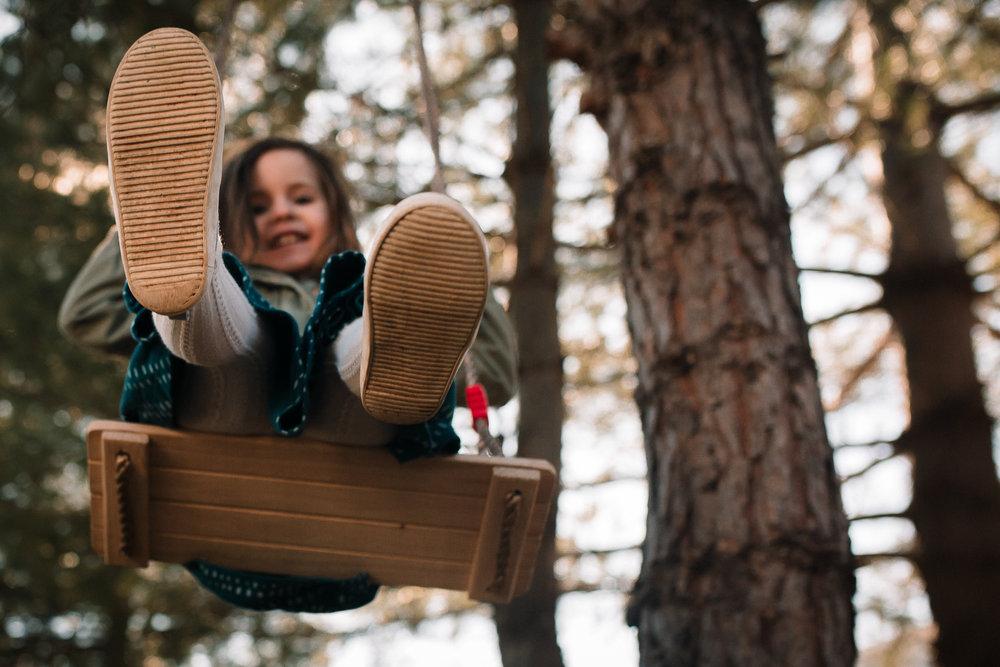 girl swinging on wooden swing lifestyle documentary family Ashburn Loudoun northern Virginia  childhood Marti Austin Photography