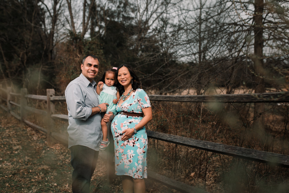 Family of three mother father daughter maternity lifestyle documentary Claude Moore Park Heritage Farm Museum Sterling Loudoun Virginia Marti Austin Photography