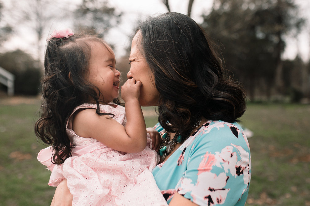 mother daughter laugh kiss maternity lifestyle documentary family Claude Moore Park Heritage Farm Museum Sterling Loudoun Virginia Marti Austin Photography