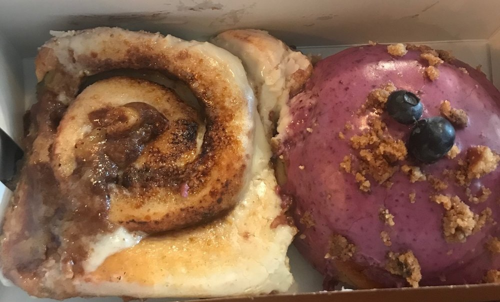The cinnamon roll donut (left) and the blueberry cheesecake donut (right).