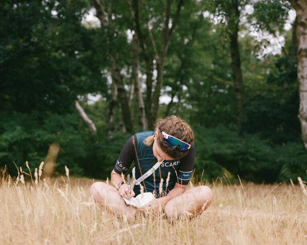 EM WRITING IN BOOK.jpg