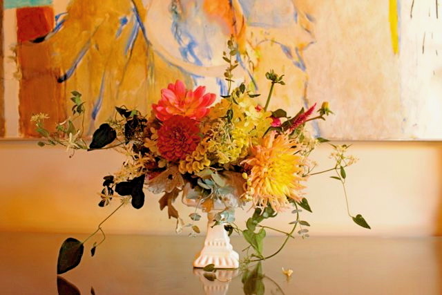 loose arrangement of dahlias, zinnia and sweet autumn clematis in vintage candy dish