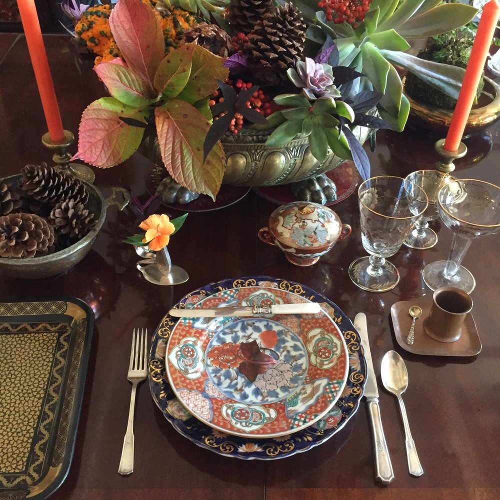 Thanksgiving tablescape with succulents, berries and fall foliages in a vintage brass planter