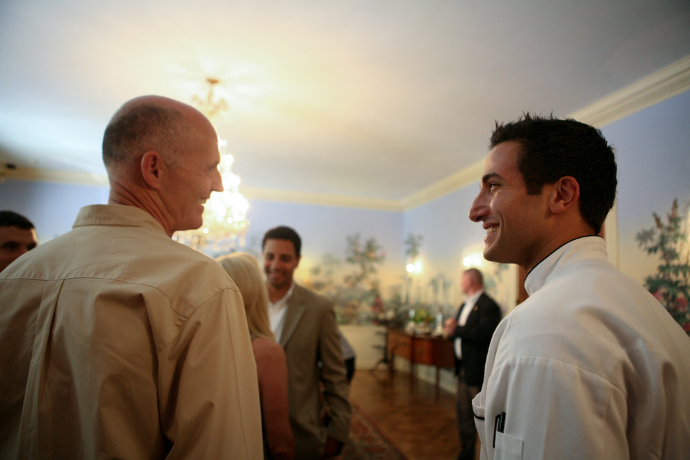Governor Rick Scott and Chef Minas sharing a moment in the State Dining Room after the  Great American Seafood Cook-off  tasting.
