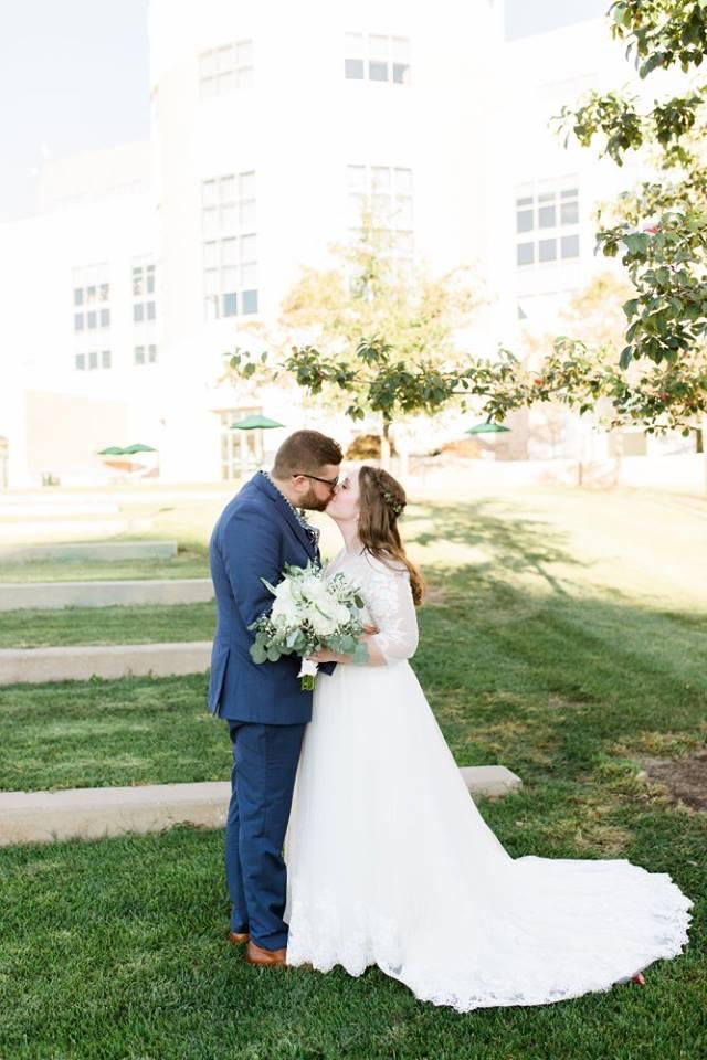 BridesbyYoung-RealBride-PlusSizeCurvyWeddingDress-JessicaRobert-8.jpg
