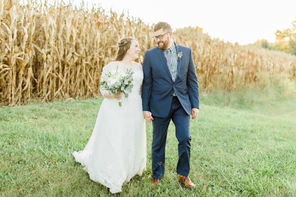 BridesbyYoung-RealBride-PlusSizeCurvyWeddingDress-JessicaRobert-4.jpg