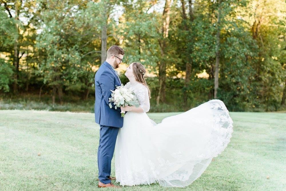 BridesbyYoung-RealBride-PlusSizeCurvyWeddingDress-JessicaRobert-3.jpg