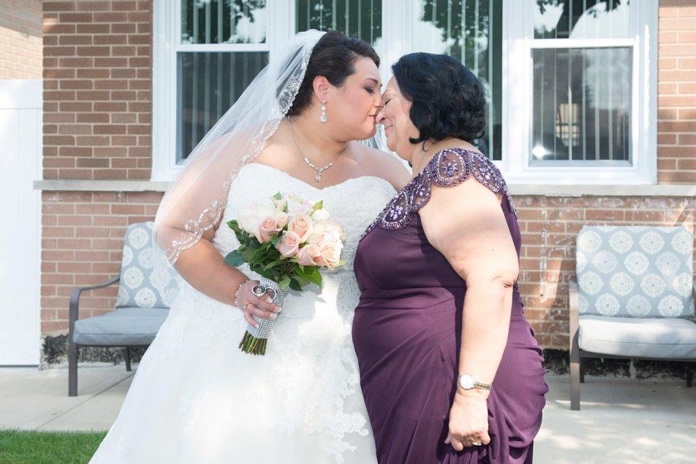 BridesbyYoung-RealBride-PlusSizeCurvyWeddingDress-MargieMichael-16.jpg