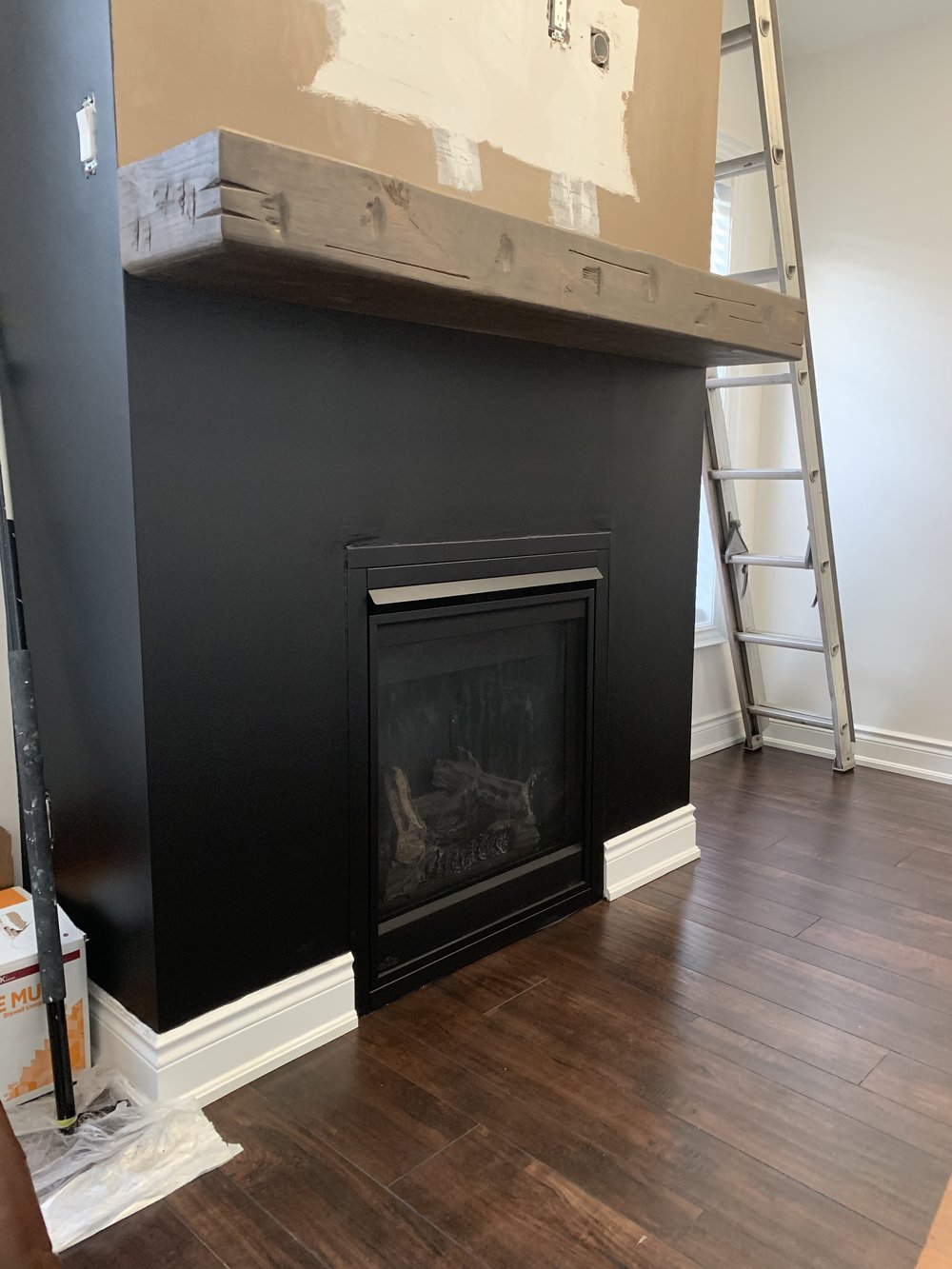 At this point we decided the trim around the fireplace needed to be painted Limousine Leather too!