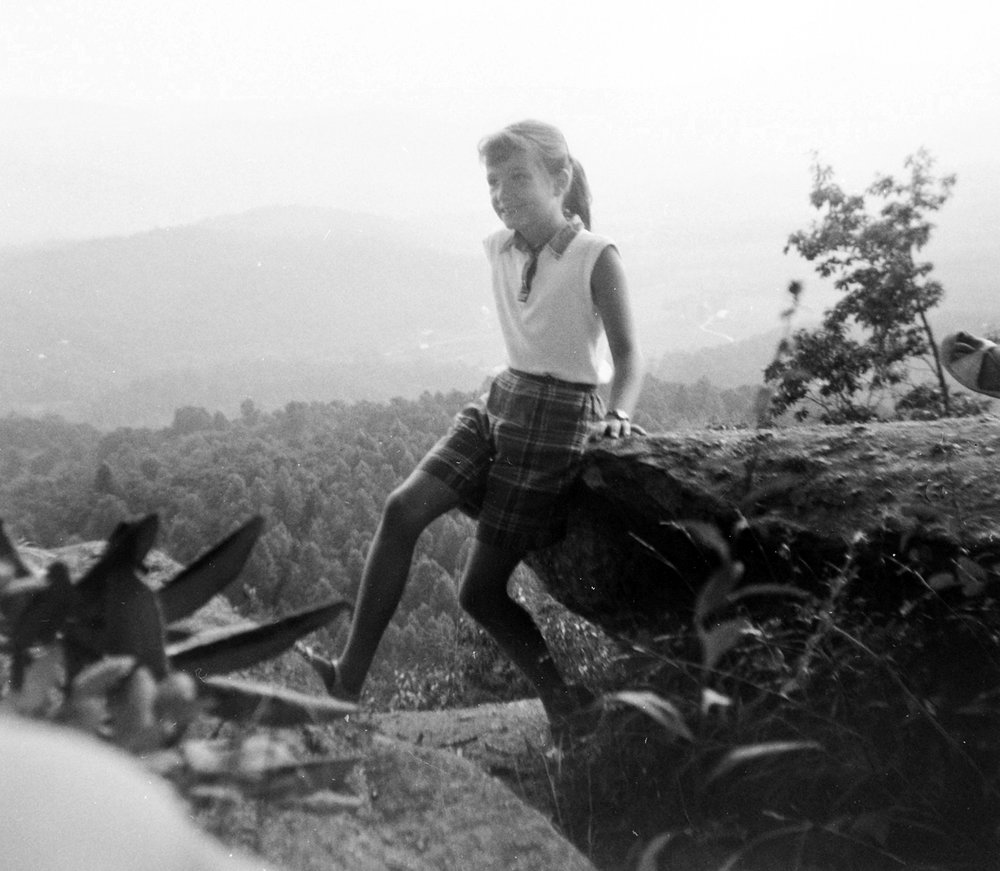 Delia enjoys a mountain top in North Carolina during a family vacation in 1960.