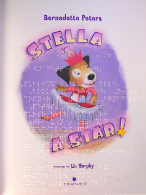 Stella Is a Star!    by Bernadette Peters   Stella Is a Star!  is an inspiring story about a pit bull puppy who wishes she were a pig so people would like her. The story uses the elegant backdrop of ballet to teach readers about self-acceptance, following one's dreams, and not judging a book by its cover.