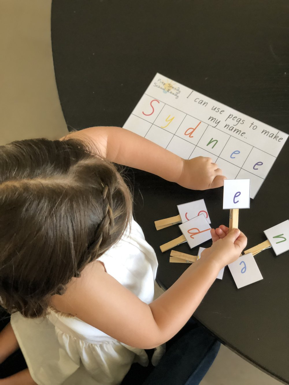 Learning the letters in her name in a fun way.