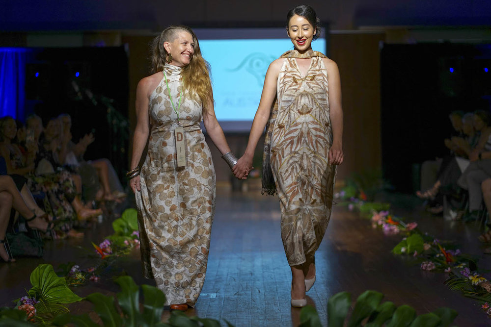 BirdTribe designer, Nina Blackcockatoo of Queensland walks with one of the models during her finale in Port Douglas. (Photo: Port Douglas Photographer)