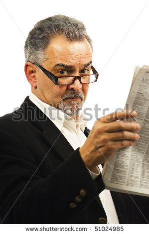 stock-photo-an-older-businessman-with-glasses-holds-up-a-newspaper-51024985