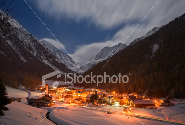 stock-photo-5919157-winter-mountain-village-at-night