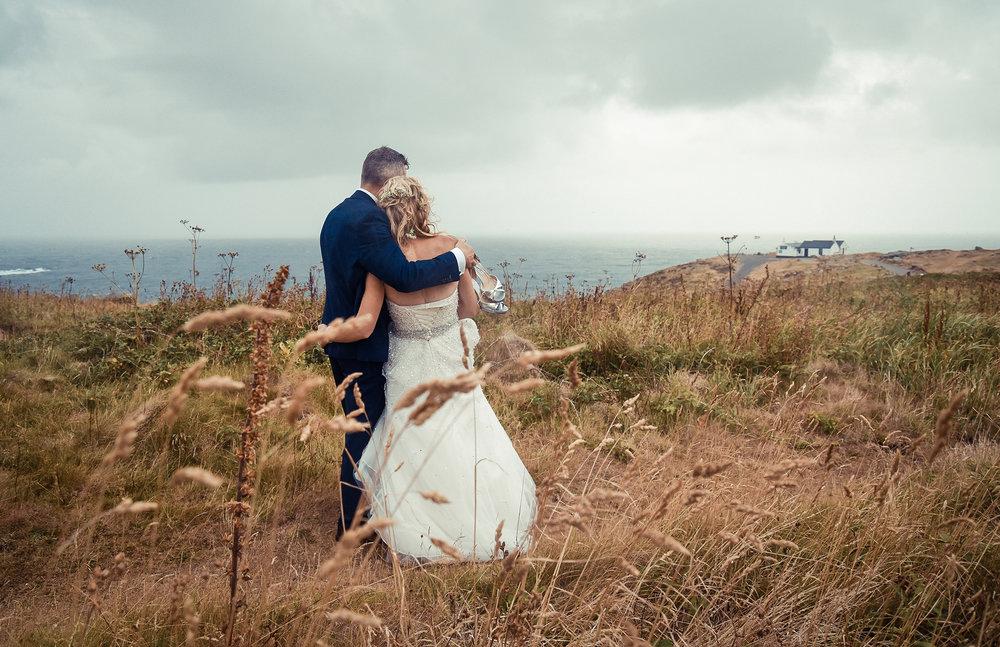 Wedding couple coast Cornwal Lands End