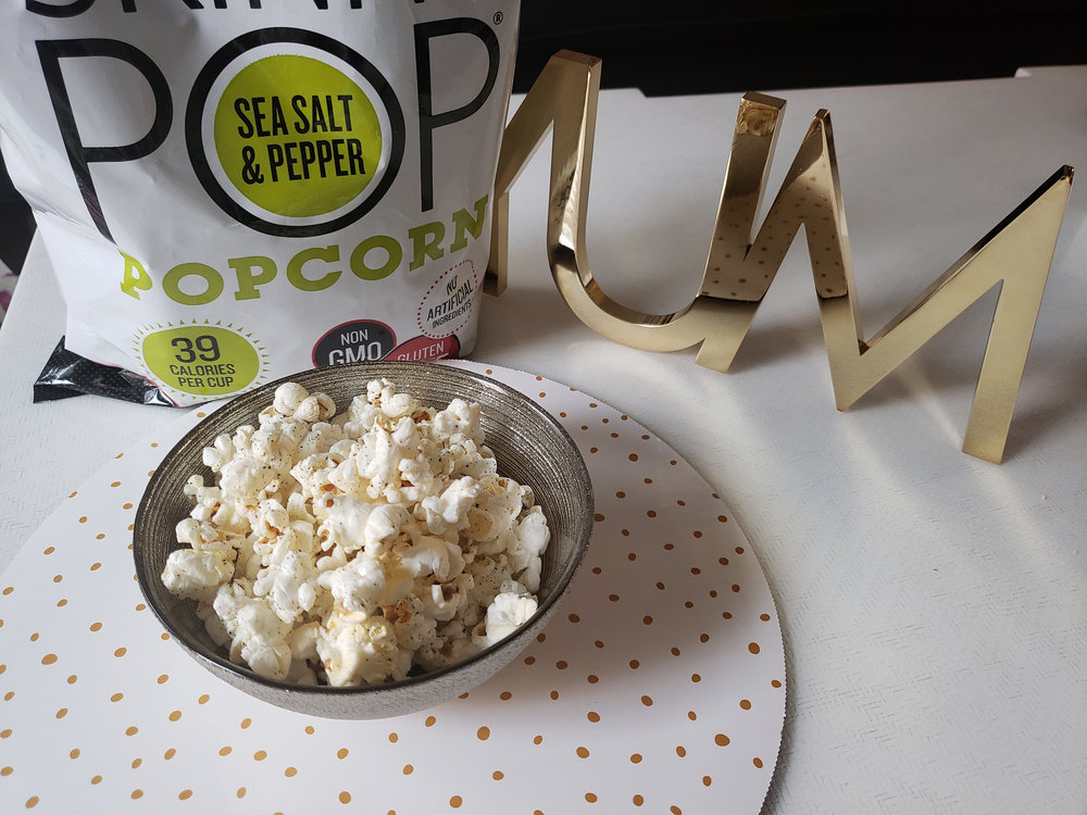 - Popcorn is BAE. Seriously. Popcorn is before anything else. And our addiction to it is a problem. We would love to sit in front of the television with all the flavored popcorn we can find. But, again, we got goals! So when it comes to filling our need, we grab a bag of Skinny Pop's Black Pepper and Sea Salt.  Popcorn can be a healthy, fiber-rich snack when consumed in moderation. We recommend breaking out appropriate serving sizes into snack size plastic bags. Never open and eat straight out of the bag, or you just might run through half a package in an episode of Queen Sugar.