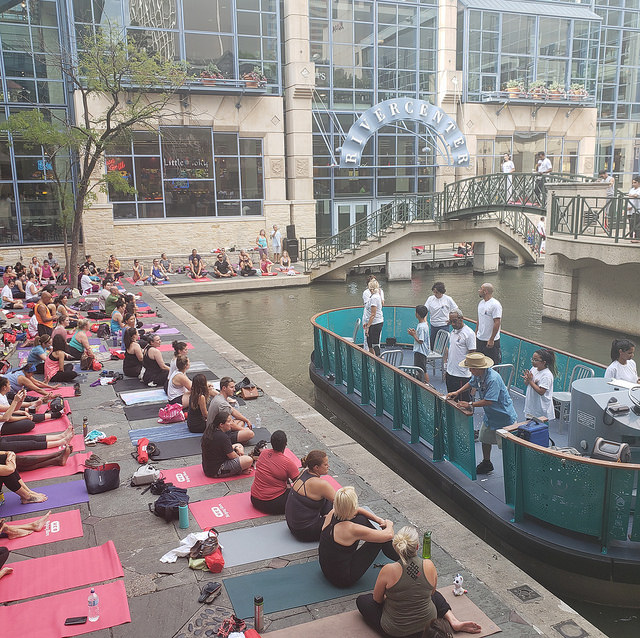 Every city has its own vibe. - It just so happens my visit to San Antonio was during Interational Day of Yoga. Hundreds came out to enjoy yoga on San Antonio's River Walk
