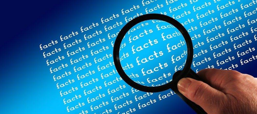 magnifying-glass-looking-at-facts