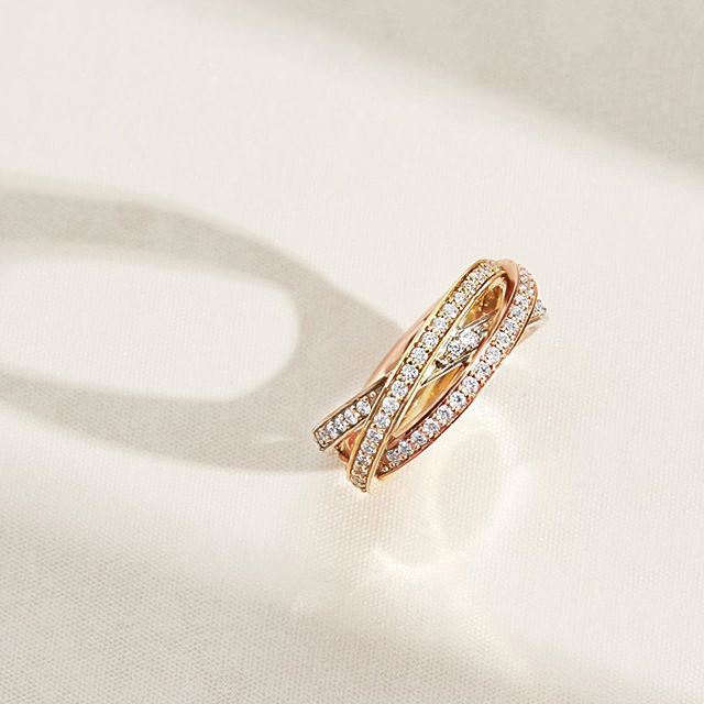 Three diamond pavé bands in contrasting golds are interwoven together to constitute a flowing design that delicately encircles your finger. Each thread represents past, present and future and is an ideal symbol of your engagement. 1.00 total carat weight #EcksandWedding