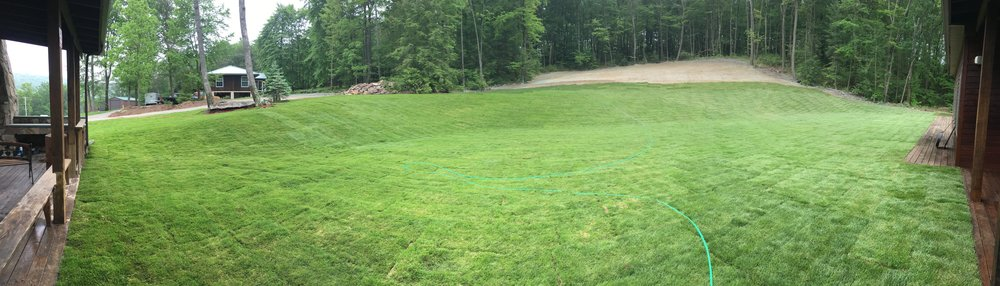 What a difference grass makes! Sod went down on the newly excavated hill early June 2018.